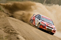 Red and blue Mitsubishi Lancer at rally Stock Images