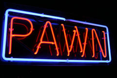Red and Blue Neon Pawn Shop Sign. Lights up the night Stock Photos