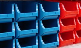 Stack-store-box-plastic. Red and blue open stackable boxes of plastic royalty free stock image