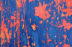 Red, Blue and Orange Distressed Metal Background Texture. Background texture of orange and blue paint peeling off a metal plate royalty free stock image