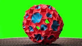 Red and blue origami magic ball. Green hromakey background for keying stock video