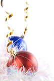 Red and blue ornaments. A pair of red and blue Christmas ornaments as a border with space for text Stock Images