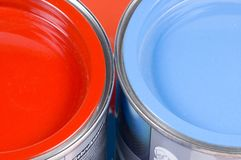 Red and blue paint. Two tins with red and blue paint stock photos