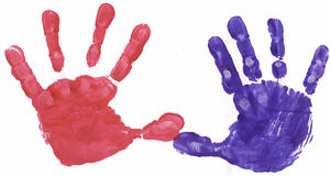 Red and Blue painted hands. Red and Blue finger painted hands Royalty Free Stock Photo
