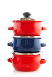 Red and blue pans. Stacked red and blue pans for cooking Royalty Free Stock Image
