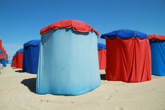 Red and blue parasols on beach Stock Photo