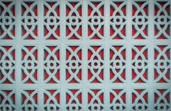 Red and blue pattern on the wall Stock Photo