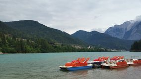 Pedalos on the lake. Red and blue pedalos on the river of a lake in Italy stock photos