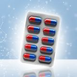 Red and blue pills in a blister on bokeh background. 3d rendering Stock Image