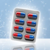 Red and blue pills in a blister on bokeh background. 3d rendering Stock Photo