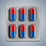 Red and blue pills in a blister on gray background. 3d rendering Stock Photography