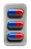 Red and blue pills in blister packaging isolated on white background. 3d rendering Stock Photos