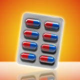 Red and blue pills in a blister on yellow background. 3d rendering Stock Images