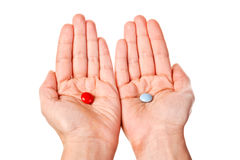 Red and blue pills in woman hands Stock Photos