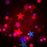 Red, blue and pink stars. Over dark background with feather center Royalty Free Stock Photos