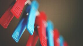 Red and Blue Plastic Pegs Royalty Free Stock Photo