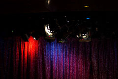 Red blue purple curtain on empty stage with bright light spots s Stock Photography