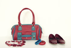 Red and blue purse with matching necklace, bracelets and flats. Stock Image