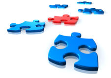 Red and blue puzzle pieces Stock Image