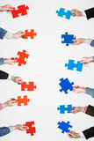 Red and blue puzzle pieces in people hands Royalty Free Stock Photos
