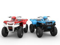 Red and blue quad bikes side by side Royalty Free Stock Images
