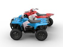Red and blue quad bikes - side view Royalty Free Stock Photography