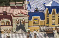 Red and blue roofs of luxury houses. Few colourful houses and roofs in luxury district in Kiev, Ukraine Royalty Free Stock Images