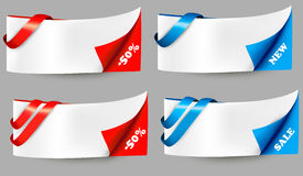 Red and blue sale banners with ribbons. Royalty Free Stock Photo