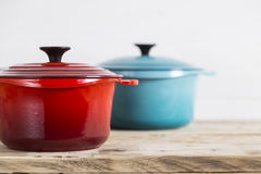 Red and blue saucepans Stock Image