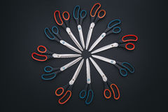 Red and blue scissors are on table Royalty Free Stock Image