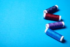 Red and blue sewing threads. stock photos
