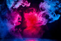 Red and blue smoke patterns stock photography