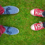 Red and Blue Sneakers shoes walking on grass top view. Red and Blue Sneakers shoes walking on grass concrete top view , Canvas shoes walking on concrete , two Stock Image