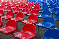 Red and blue stadium seats Stock Photo