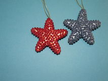 Red and blue stars. Festive red and blue stars on the blue background, isolated, holiday Royalty Free Stock Photography