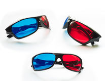 Red and blue on stereo glasses. For three dimensional movie on white background stock images
