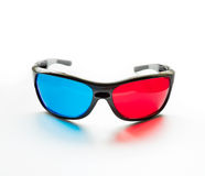 Red and blue on stereo glasses. For three dimensional movie on white background royalty free stock photos