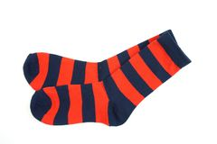 Red and blue stripe socks isolated on white background. Red and navy blue stripe socks isolated on white background stock photography