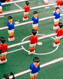 Red and Blue Table Football Players Arranged around Centre Circle Stock Images