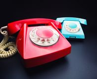 Red and blue telephones Royalty Free Stock Image