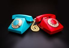 Red and blue telephones Stock Photography