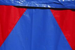 Red-blue  tent tarpaulin. Red-blue tent tarpaulin from a tent Stock Photography