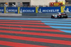 Red and blue track on Paul Ricard. LE CASTELLET, FRANCE, April 7, 2018 : Racing cars and teams during the training sessions for World Endurance Car Championship Stock Images