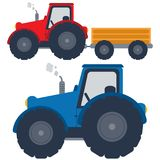 Red and blue tractors with trolley Stock Photography