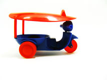 Tuk-tuk toy for a child. Isolated rd and blue tuk tuk toy Royalty Free Stock Image