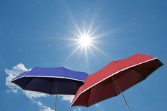 Red and blue umbrella, bright sunny sky Royalty Free Stock Photography
