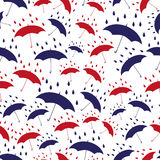 Red and blue umbrellas white seamless pattern Stock Photo