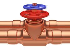 Red and blue valves on copper pipes closeup Royalty Free Stock Image