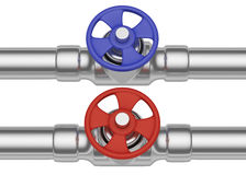 Red and blue valves on steel pipes front view Royalty Free Stock Photos