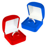 Red and blue velvet boxes with platinum ring Stock Photography